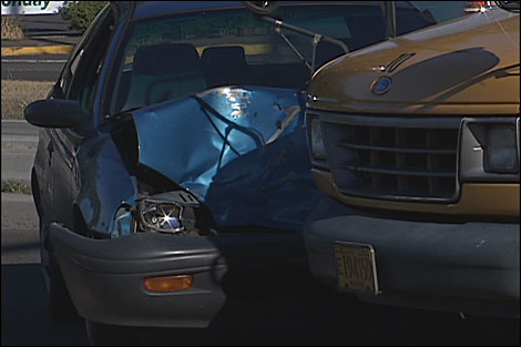 Car, school bus collide on Franklin Boulevard